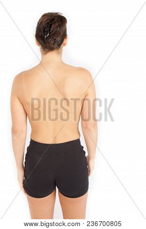 Rear Back View Of Fit Woman Top Less In Sport Clothes