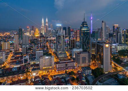 Kuala Lumpur, Malaysia - September 24, 2016: Kuala Lumpur city view at night with famous Petronas towers and Menara KL tower, Malaysia