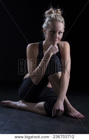 Beautiful Fit And Healthy Blond Woman Portrait In A Black Top Crouch On Floor