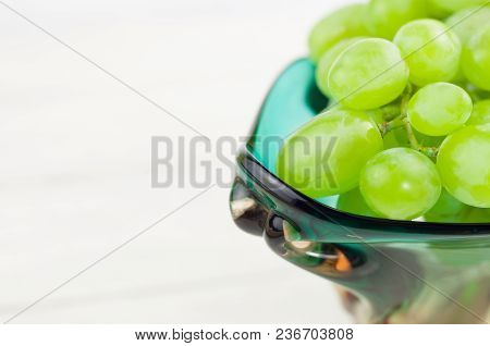 Bunch Of Fresh Ripe Green Grapes In Glass Vase On Old Wooden Rustic White Planks