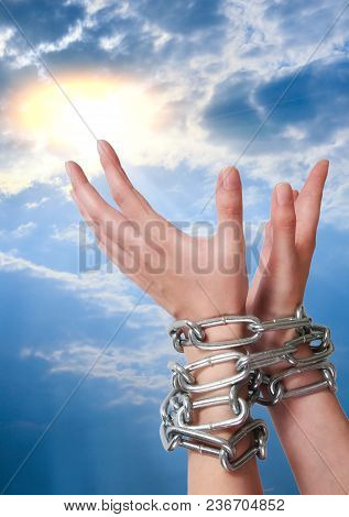 Female Hands Tied By Chain Lifted To Sun