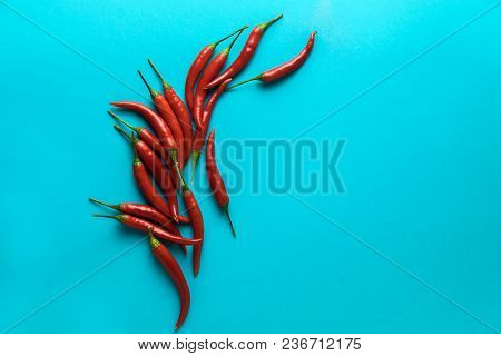 Group Of Little Red Hot Chili Peppers On The Blue Background