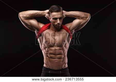 Cute Young Sports Man In Red T-shirt Shows Relief Abdominal Muscles In Gym.
