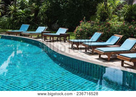 Nobody Lounge Chairs Near Swimming Pool