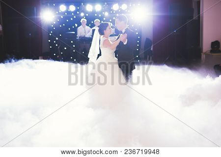 Beautiful Caucasian Wedding Couple Just Married And Dancing Their First Dance.