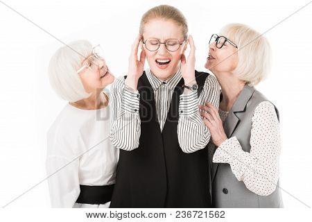 Mature Stylish Businesswoman Shutting Ears Between Two Senior Businesswomen In Eyeglasses Isolated O
