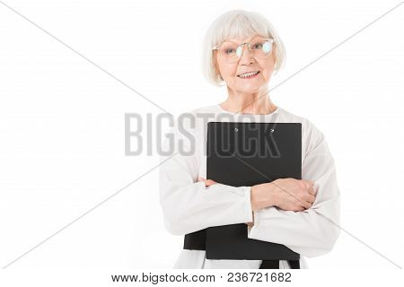 Stylish Senior Businesswoman In Eyeglasses With Clipboard In Hands Isolated On White