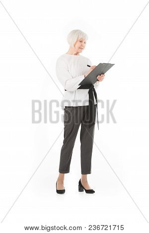 Senior Stylish Businesswoman Writing On Clipboard Isolated On White