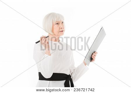 Senior Stylish Businesswoman Standing With Clipboard And Pen Isolated On White