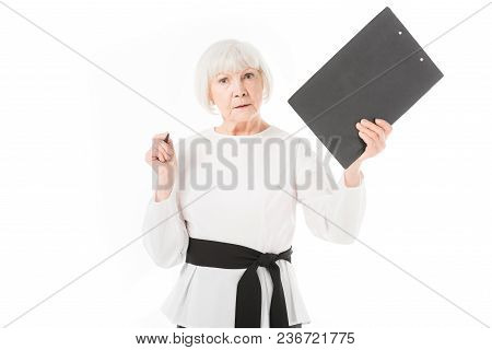 Serious Senior Businesswoman With Clipboard And Pen Isolated On White