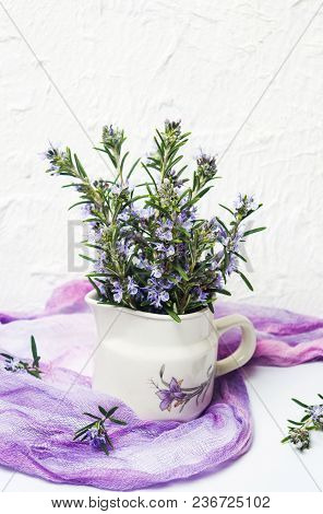 Rosemary Branches In A Vase On White Background Side View