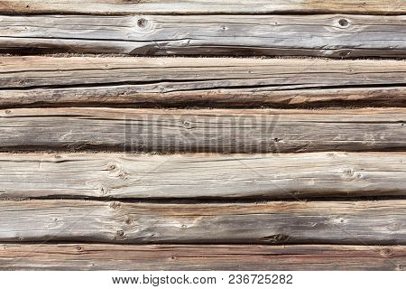 Background Of Logs, Old Wooden Log Cabin With A Crevice, The Old Rustic Wall Of The Hut,