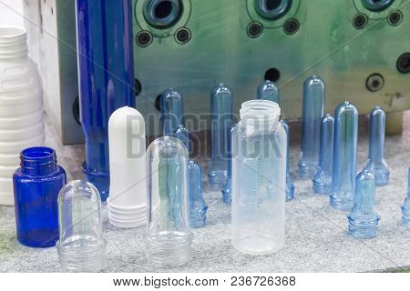 The Various Type Of Plastic Bottle Product With Injection Mold Background.