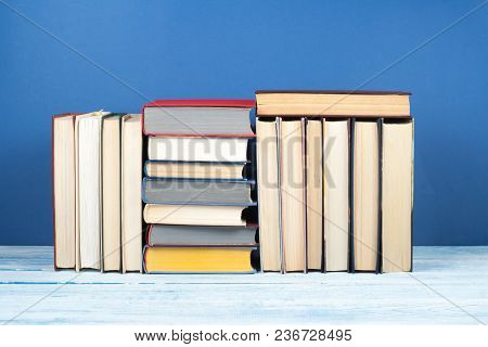 Book Stack, Hardback Colorful Books On Wooden Table And Blue Background. Back To School. Copy Space