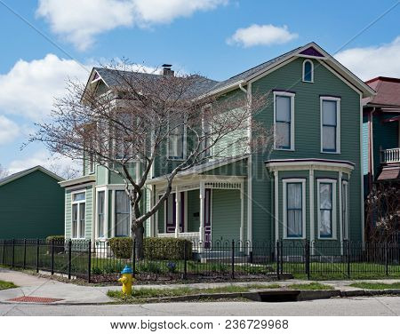 Teal Victorian Corner House with Purple Accents