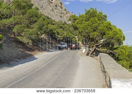 Novyy Svet, Crimea - September 7, 2017: Cars On A Narrow Mountain Road. Sunny Summer Day. (the Road