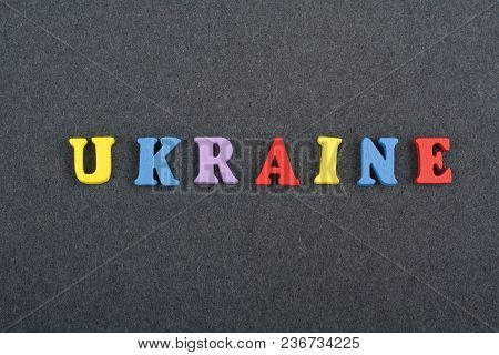Ukrainian Word On Black Board Background Composed From Colorful Abc Alphabet Block Wooden Letters, C