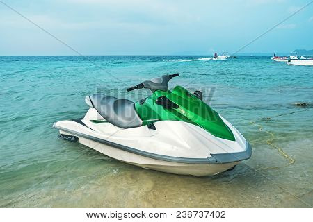 Jet Ski On The Beach. Jet, Ski, Water Motorcycle. The Concept Of Marine Entertainment In The Summer