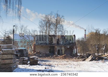 View Of A Dilapidated House. The Destroyed Walls In The Process Of Demolishing The Dilapidated House