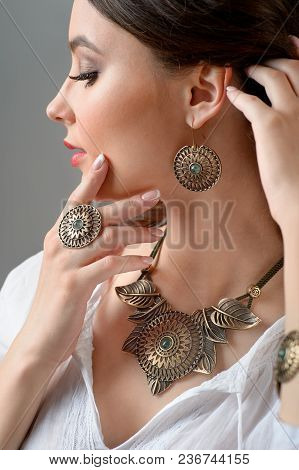 Necklace With Precious Stone On Neck And With Finger Ring And Earring. Close-up Studio Isolated Shot