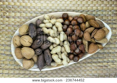 Mix Of The Nuts. Almonds, Pecans, Hazelnuts, Walnuts, Peanuts Placed In Eco Natural Banana Leaf Plat