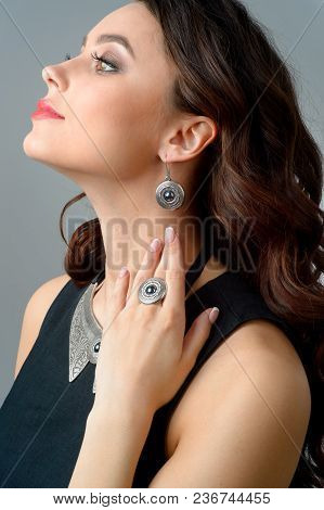 Portrait Of Young Beautiful Woman With Long Brown Hair Fresh Skin Wearing Accessories And Jewelry Is