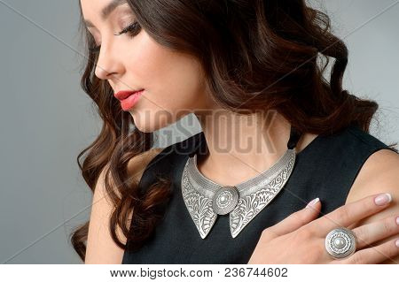 The Young Beauty Model With Silver Pendant.