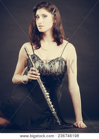 Music Performance. Stunning Elegant Young Lady With Transverse Flute Instrument On Black. Woman Prep