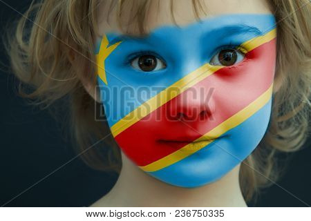Portrait Of A Child With A Painted Flag Of Democratic Kongo On Her Face, Closeup.