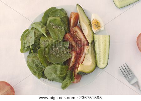 Flat Lay With Arranged Salad In Bowl, Spices And On White Tablecloth. Healthy Vegetarian Food