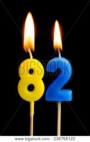 Burning Candles In The Form Of 82 Eighty Two (numbers, Dates) For Cake Isolated On Black Background.