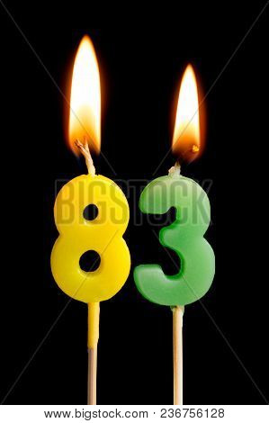 Burning Candles In The Form Of 83 Eighty Three (numbers, Dates) For Cake Isolated On Black Backgroun