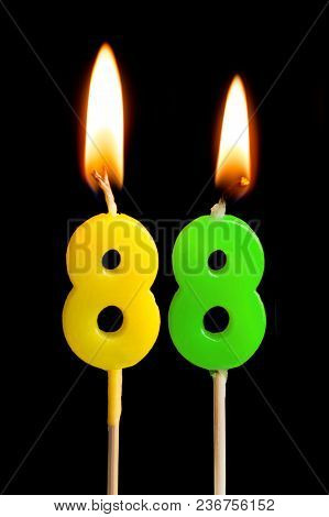 Burning Candles In The Form Of 88 Eighty Eight (numbers, Dates) For Cake Isolated On Black Backgroun