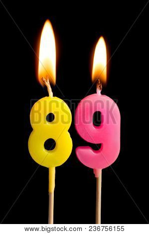 Burning Candles In The Form Of 89 Eighty Nine (numbers, Dates) For Cake Isolated On Black Background