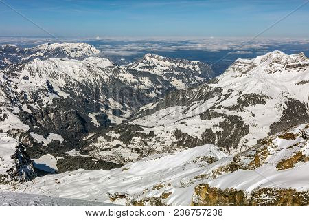 A Wintertime View From Mt. Titlis In Switzerland. The Titlis Is A Mountain, Located On The Border Be