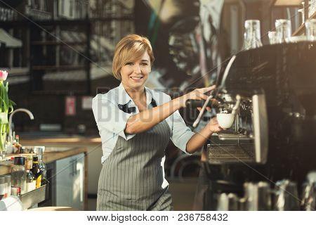 Happy Experienced Barista Making Coffee In Professional Coffee Machine. Woman Preparing Beverage. Sm