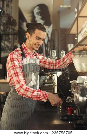 Happy Barman Making Espresso In Modern Coffee Machine. Man Preparing Bracing Beverage. Small Busines