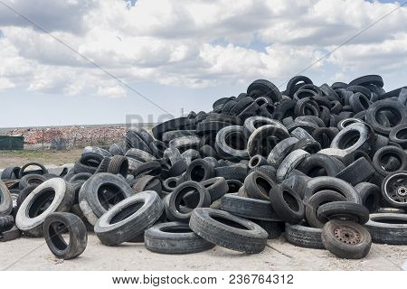 Collier County, Florida, Usa - April 3, 2018: Used And Discarded Tires Are Piled Up In Recycling Are