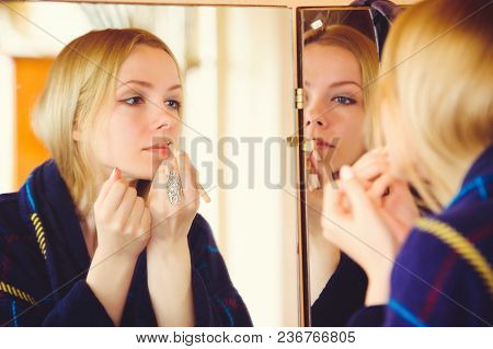 Cute Blonde Woman Doing Make-up At Home, Touching Face Dressed In Blue Dress, Beautiful Portrait In