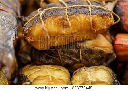 Various Smoked Fish Tied With A Tourniquet, Prepared Tasty Seafood Background, Macro Photo