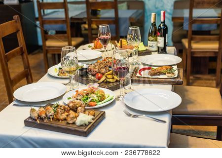 Table Setting With Food In The Restaurant