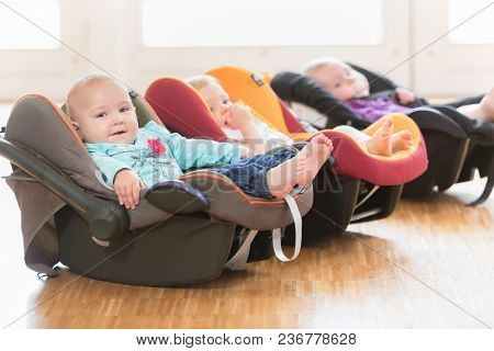 Infants in toddler group lying in baby shells
