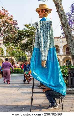 Antigua, Guatemala -  March 9, 2018: Man Rests Inside Traditional Giant Folk Dancing Puppet Called A