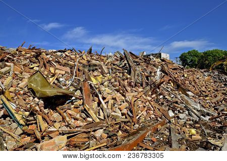 An Old Brick Building Is Torn Down And Left In A Heap Of Rubble