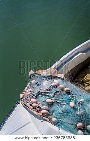 Close Up Detail Of A Fisherman Boat And Fishing Net On The Shore Of A River In Ada Bojana, Montenegr
