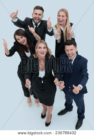 view from the top.happy business team holding up a thumbs up.