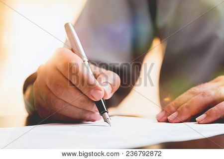 Business Man Signing An Official Document In Office