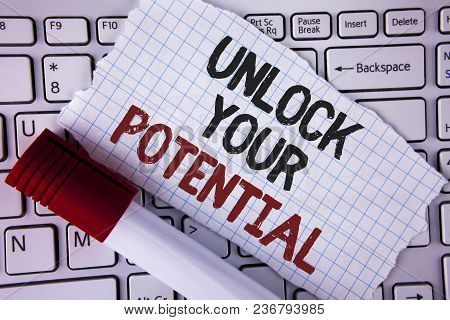Conceptual hand writing showing Unlock Your Potential. Business photo text Reveal talent Develop abilities Show personal skills written Tear Notebook paper placed the Laptop Marker next to it.. poster