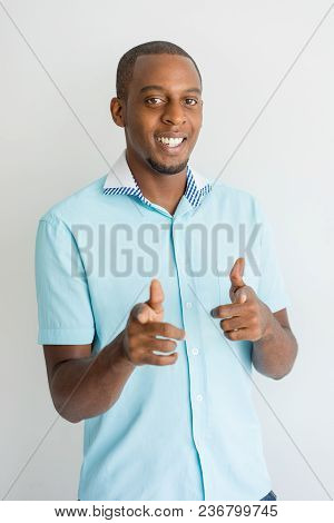 Happy Optimistic African Man Making Finger Guns And Pointing At Camera. Portrait Of Cheerful Success