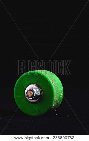 Old Vintage Consumed Skate Wheel On A Black Background